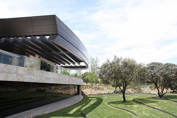 curved spanish home Spanish Home Clad in Dark Stone Assures Privacy and Serenity