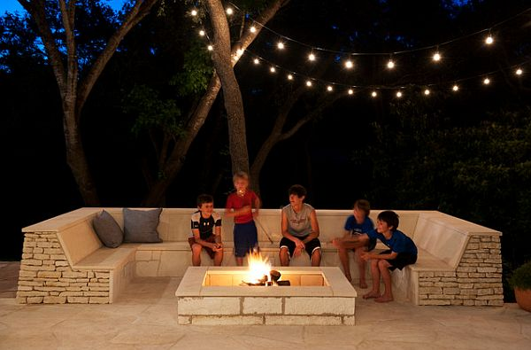outdoor space with built-in seating and firepit