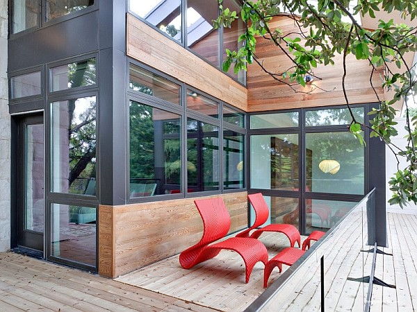 small outdoor terrace with red plastic chairs