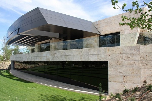 spanish home Spanish Home Clad in Dark Stone Assures Privacy and Serenity
