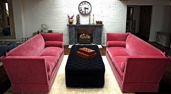 Stylish pink knole sofa adds color to a traditional living room