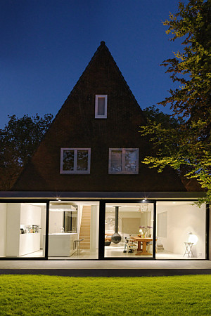 triangle amsterdam house at night
