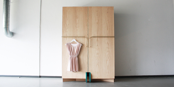 walk in closet for small spaces Ergonomic Walk In Closet Opens Up Into a Stylish Mini Fitting Room