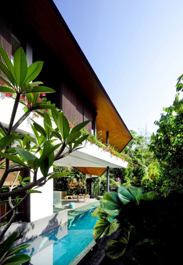 winged house flower terrace Asian House Design in Beautiful Tropical Setting