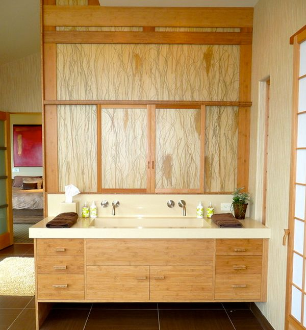 Artistic floating bathroom vanity draped extensively in light grain wood