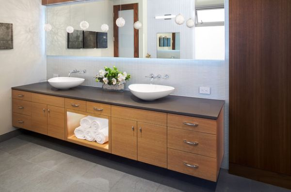 Beautifully back lit mirror atop a gorgeous floating sink in wood 27 Floating Sink Cabinets and Bathroom Vanity Ideas