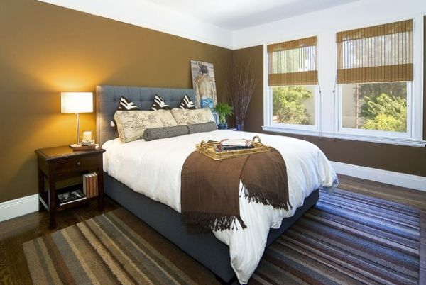 Brilliant modern bedroom with gray tufted headboard and chic zebra pillows