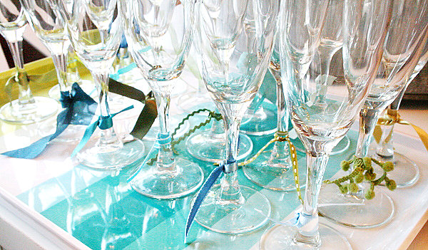 Champagne glasses embellished with ribbon
