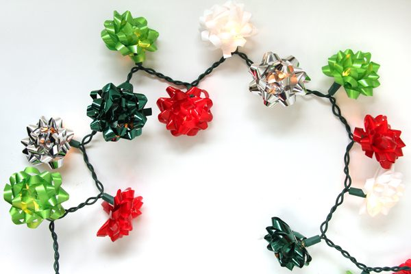 12 diy christmas garlands that celebrate holiday cheer view in gallery christmas bow light garland solutioingenieria Images