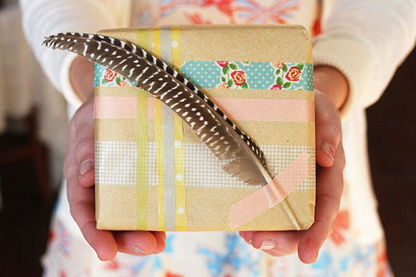 Christmas gift wrap with a feather Stylish Holiday Gift Wrap Ideas