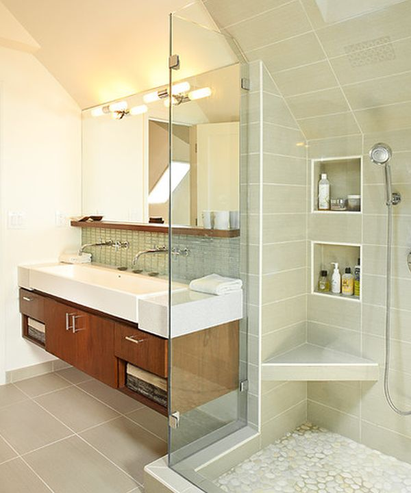 Classy floating sink cabinet set in a contemporary bathroom clad in glass