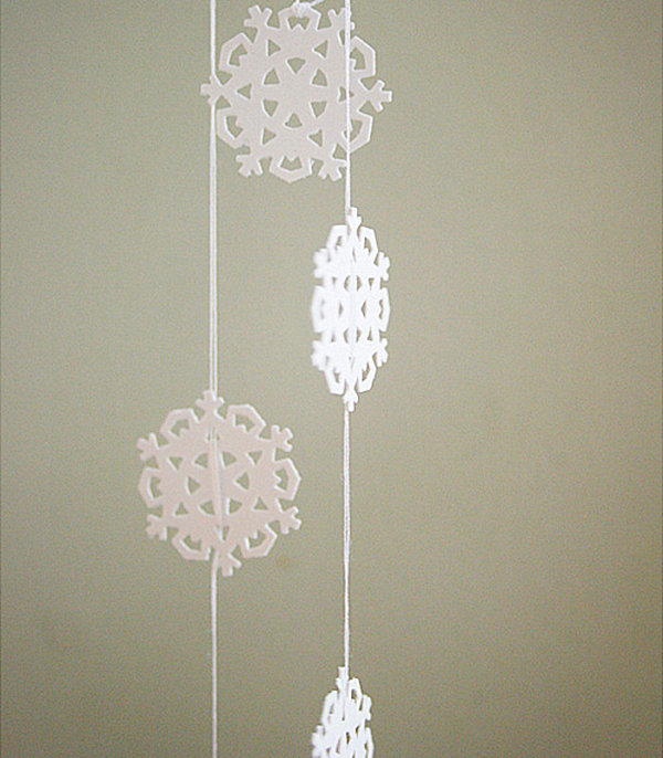 12 diy christmas garlands that celebrate holiday cheer view in gallery diy snowflake garland solutioingenieria Images