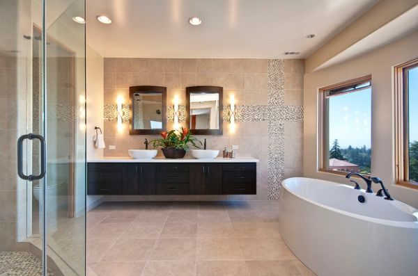 Elegant modern master bathroom with warm colors and floating cabinet