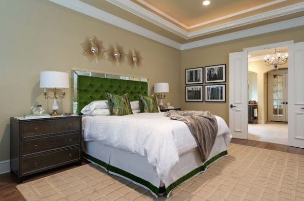 Ergonomic master bedroom with lively green tufted headboard stealing the show