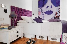 Fashionable apartment loft bedroom with bright purple tufted headboard