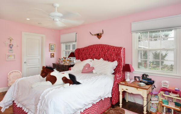 Girls' bedroom with pink upholstered tufted headboard