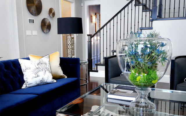 Gray living room with rich blue seating