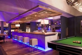 Home Bar with pool table attempts to recreate a pub atmosphere