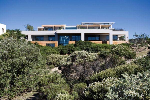 Lush green surroundings adjacent to the modern beach house