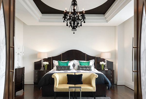 Luxury bedroom with emerald pillows to balance the neutral black and white