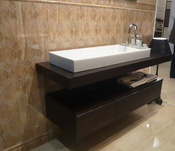 Marble floored bathroom with gorgeous floating sink and cabinet form