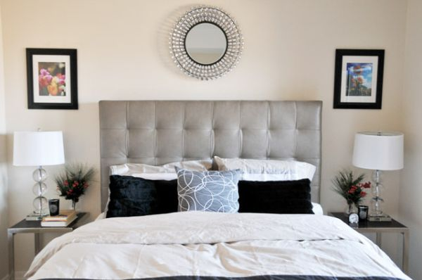 Modern bedroom sporting tufted headboard in neutral colors