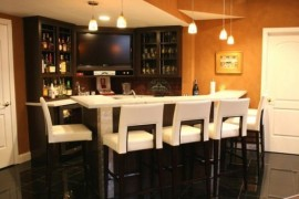 Modern home bar with pristine white seating options and countertop