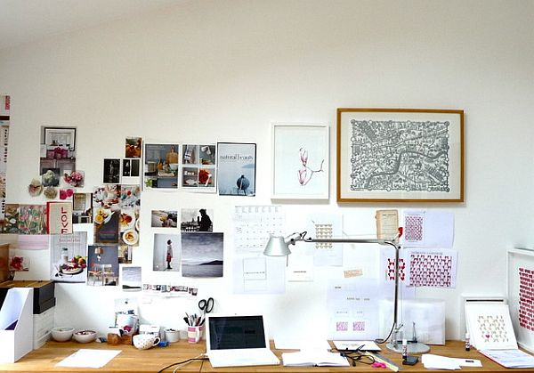 Modern office with fancy collage on the walls