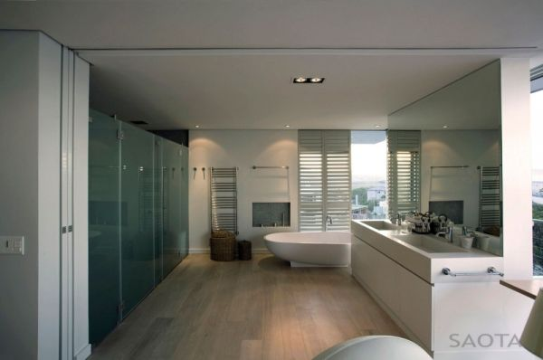Nuetral shades grace the bathrooms