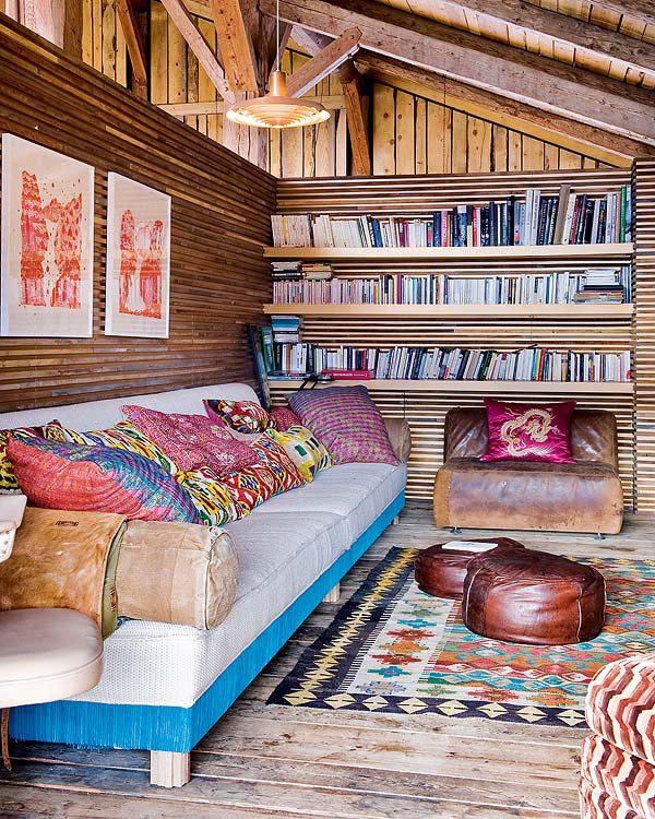 Plush couch nestled against a rustic wooden backdrop
