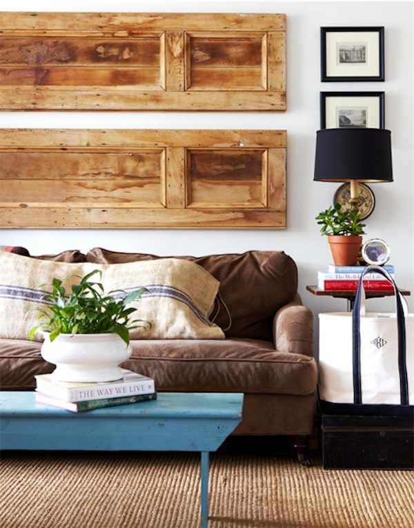 Repurposing vintage wooden doors or shutters as a dramatic piece of art