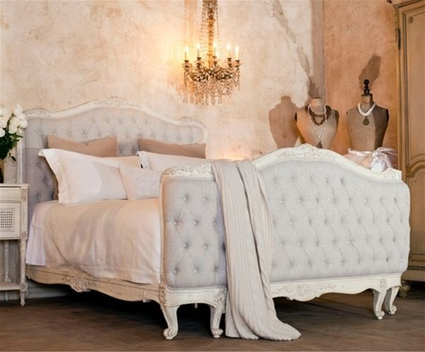Serenely lit bedroom with raishing tufted headboard