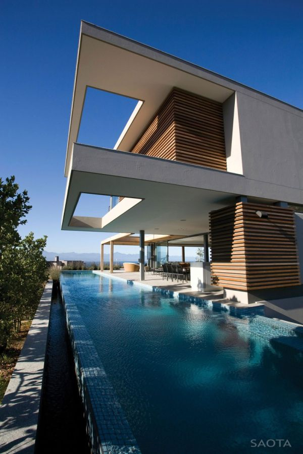 Soothing pool and natural timber wooden shutters