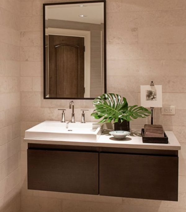 Sporadic presence of natural green to liven up the floating sink cabinet