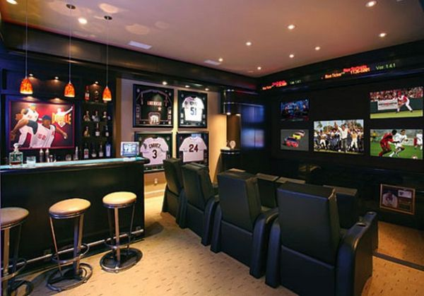Sports themed home bar clubbed with the perfect entertainment center