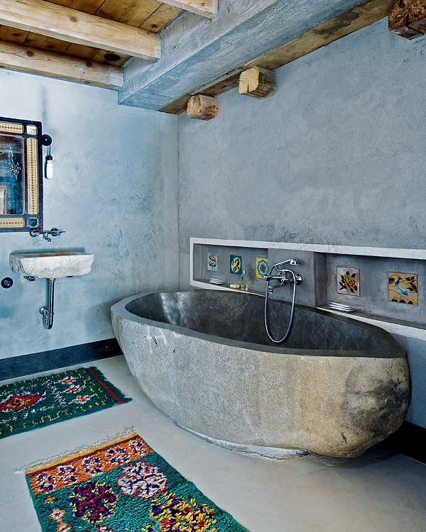 Stone bathtub offers a soothing dip