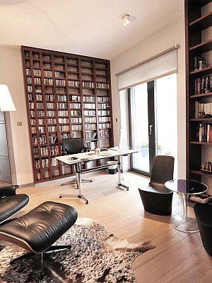 Study room with Eames lounge chair and small desk