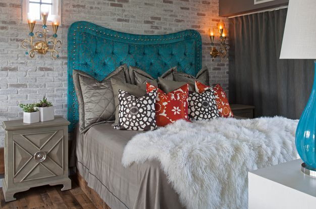 Stylish colorful headboard and cool brick wall make up a unique combination