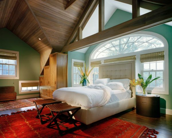 Tall tufted headboard keeps away the light from the beautiful windows behind the bed