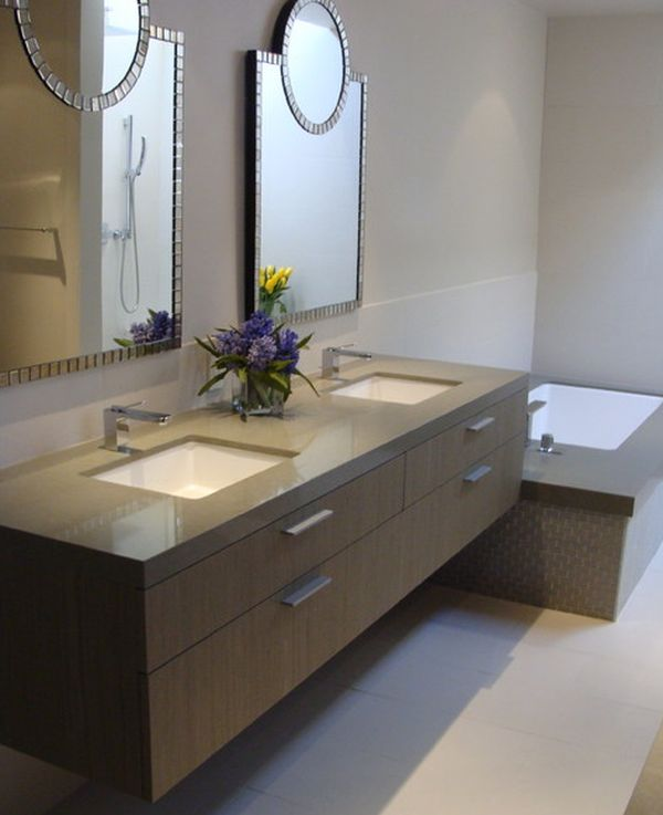 bathroom design with beautiful mirrors and brown floating sink