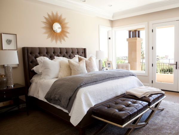 Traditional bedroom design with tufted headboard and tufted benches at foot