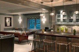 Transperant Vapor Bar Stools and Brilliant lighting help this home bar dazzle