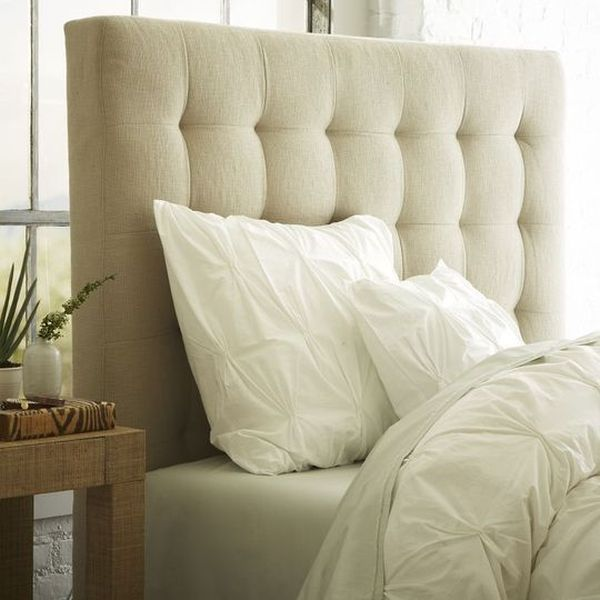 Unassuming tufted headboard in a soothing shade