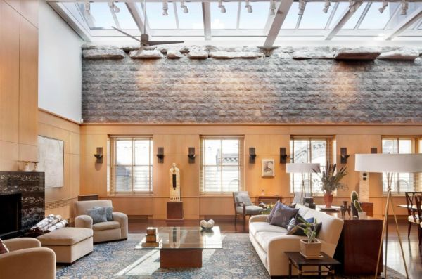 Unusual Living Room in Stone incorporated with number of Skylights