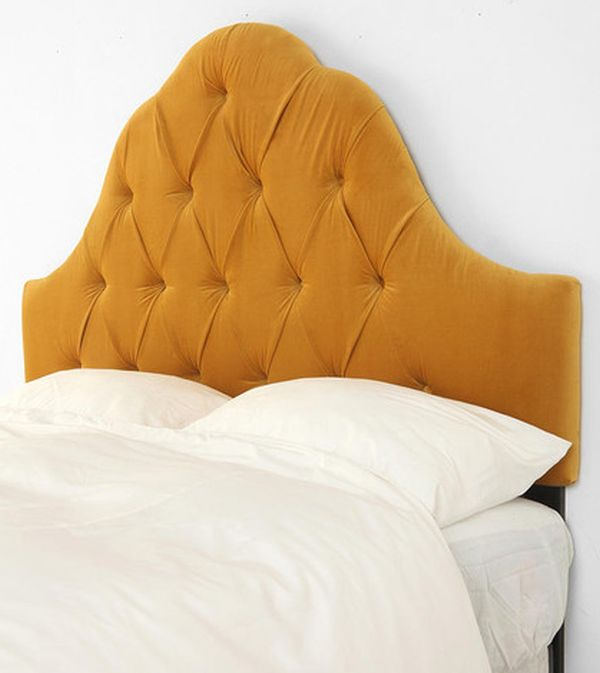Velvet tufted headboard in antique gold