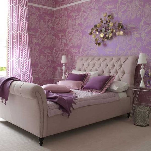 Violet walls and lovely decor enhance the beauty of this bed with tufted headboard