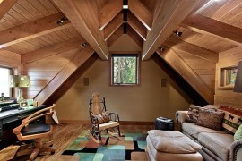 Beautiful study room in the attic, with wood furnishings
