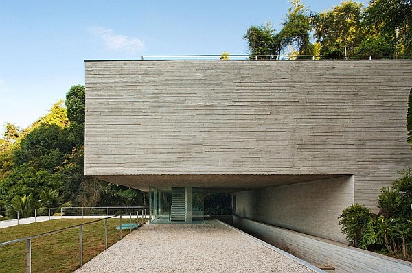 paraty house in rio brings indulgent dreams alive with the On concrete exterior walls