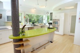 Custom built kitchen island with glossy green counter
