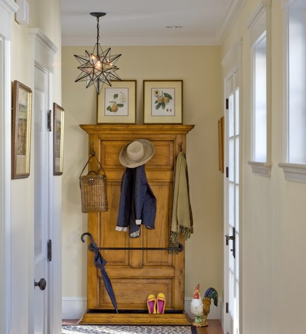 hallway coat storage idea Saving Space In Your Foyer With a Creative Coat Rack